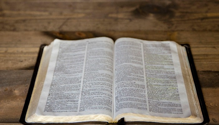 Quiet Time Open Bible on Wood Backround