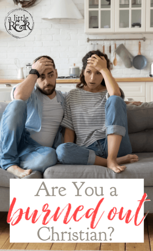 man and woman sitting on couch tired