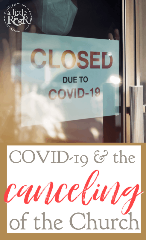 person with mask looking in store window with closed sign due to COVID-19