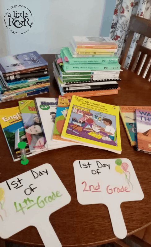 homeschool curriculum and supplies on a kitchen table