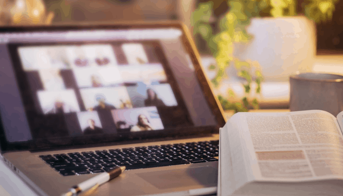 Bible open on laptop, zoom church meeting