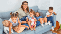 Mother with kids sitting on couch
